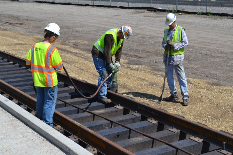 Workers working on train tracks outside