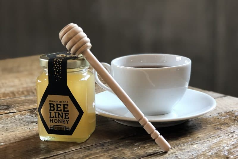 Bee Line honey jar and cup of tea