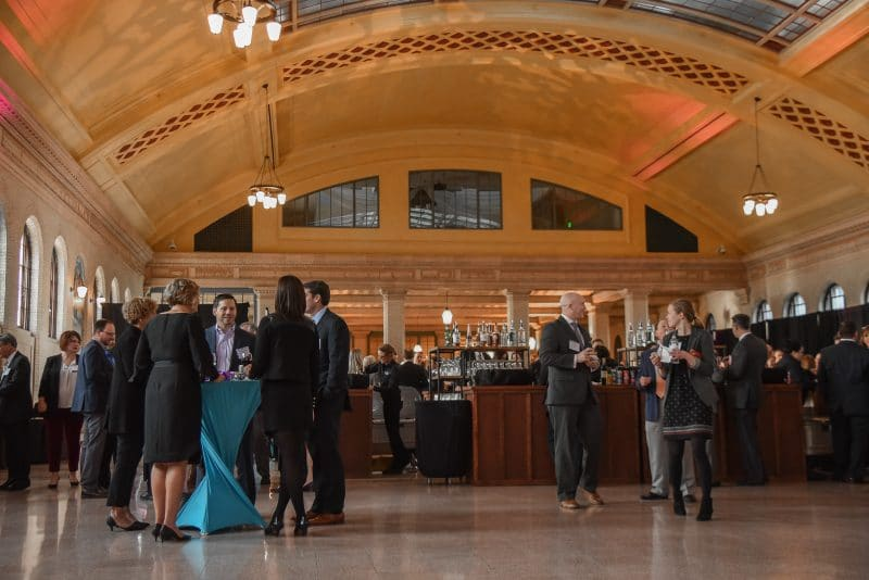 People talking at tables in Waiting Room at Union Depot
