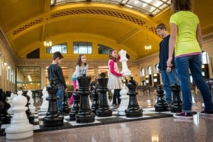 Kids playing giant chess in Union Depot's Waiting Room