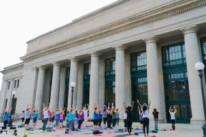 People doing yoga on Union Depot's North Plaza