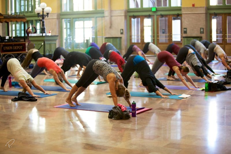 People doing yoga in Union Depot's Head House